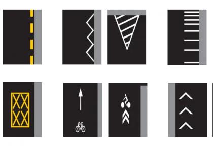 Víte, co znamenají různé čáry a symboly na silnici?